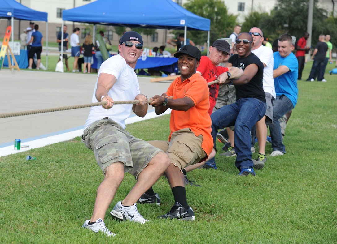 Airmen 1st Class John Boswell and Michael Barnes, 338th Training Squadron; Airmen 1st Class Jack Hansen and Jaren Kirkendoll, 335th Training Squadron; Airman 1st Class John Spencer and Airman Basic Charles Lollar, 338th TRS, pull on their side of the rope in a game of tug-of-war during the Air Force's 67th birthday celebration Sept. 19, 2014, Keesler Air Force Base, Miss. The event also included a cake cutting ceremony, music, games, contests and food.  (U.S. Air Force photo by Kemberly Groue)