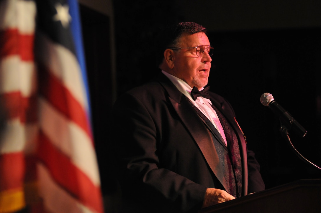 "Retired Capt. William ""Bill"" Robinson, former prisoner of war, makes remarks as the guest speaker during the Air Force's 67th Birthday Ball on Sept. 20, 2014, at the Bay Breeze Event Center, Keesler Air Force Base, Miss. The event, sponsored by the Air Force Association John C. Stennis Chapter #332, also commemorated the 50th anniversary of the Vietnam War. (U.S. Air Force photo by Kemberly Groue)"