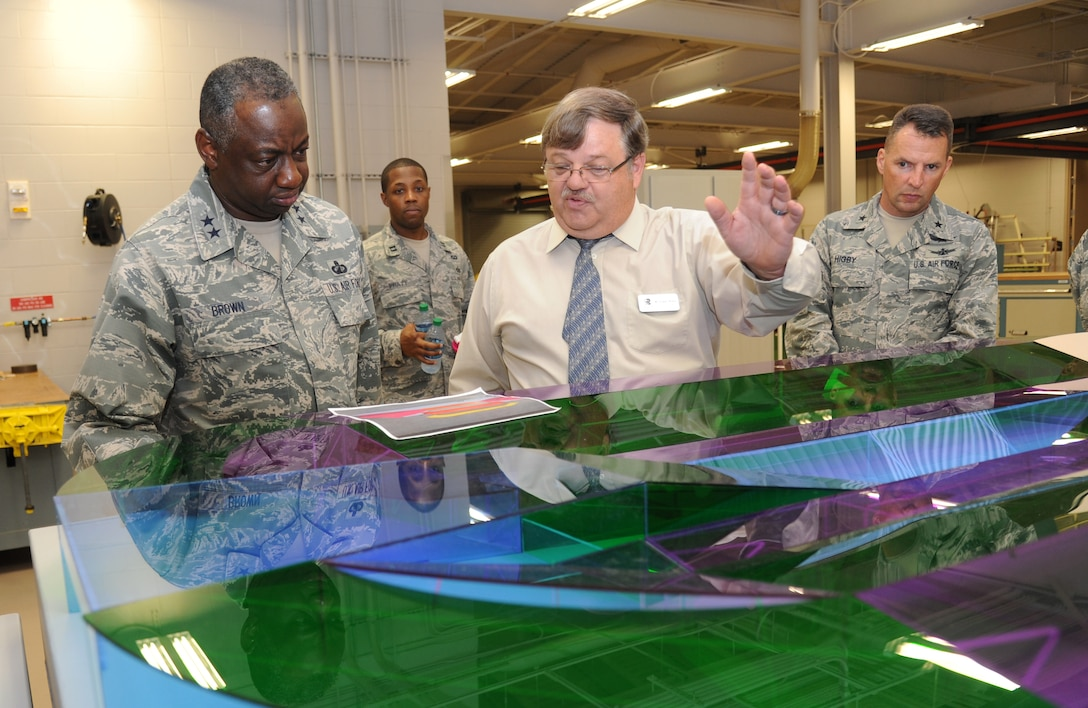Maj. Gen. Mark Brown, 2nd Air Force commander, is shown a model of the runway by Roland Wilson, 81st Training Support Squadron, which was built by the Trainer Development Facility, during a two-day immersion tour of the base Sept. 16-17, 2014, Keesler Air Force Base, Miss.  The purpose of the tour was to learn the integration of the base's mission, operations and personnel.  Brown also toured the 81st Medical Group, 81st Mission Support Group and held an all call. (U.S. Air Force photo by Kemberly Groue)