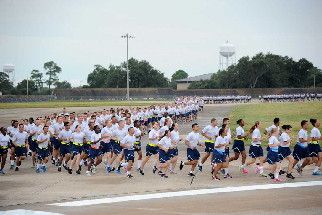 Keesler Airmen run around the flight line during a 5K run Sept. 19, 2014.  The run was the kickoff event for a day of activities in support of Wingman Day.  (U.S. Air Force photo by Kemberly Groue)