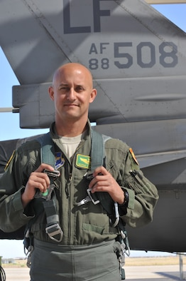 Capt. George Normandin, 56th Fighter Wing Command Post chief, received the Aviation Safety Well Done Award Sept. 2, presented by Brig. Gen. Scott Pleus, 56th FW commander. Normandin took control of an F-16 Fighting Falcon and landed it safely after an internal malfunction occurred during a training mission over Luke. (U.S. Air Force photo//Senior Airman Marcy Copeland)