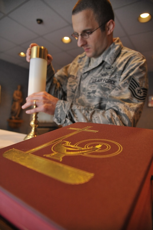 U.S. Air Force Tech. Sgt. Lukas Bartels, 509th Bomb Wing chaplain assistant, prepares altar candles for daily Mass at Whiteman Air Force Base, Mo., Sept. 3, 2014. A big part of a chaplain assistant's job is pastoral care. This involves religious support teams which normally comprised of one chaplain to one chaplain assistant.  They do unit engagements which entails the chaplain and chaplain assistant going to different squadrons to follow up with Airmen who requested their assistance. (Air Force photo by Airman 1st Class Keenan Berry/Released)