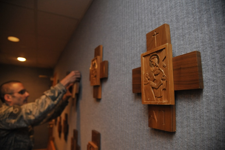 U.S. Air Force Tech. Sgt. Lukas Bartels, 509th Bomb Wing chaplain assistant, puts Stations of the Cross on chapel walls at Whiteman Air Force Base, Mo., Sept. 3, 2014. Chaplain assistants are trained in crisis intervention which entails dealing with thoughts on suicide, domestic violence and sexual assault.  Situations requiring immediate attention can be dealt with by either the chaplain or assistant. (U.S. Air Force photo by Airman 1st Class Keenan Berry/Released)