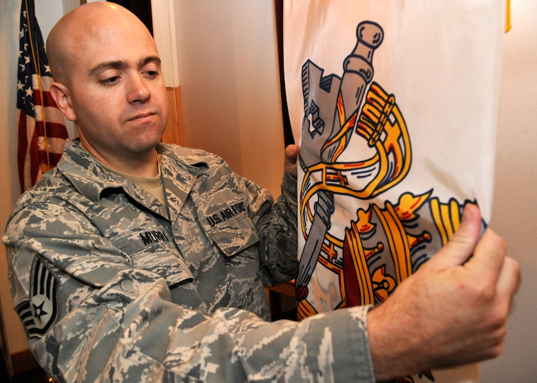 U.S Air Force Staff Sgt. Ronald Murray, 509th Bomb Wing chaplain assistant, prepares for Catholic services at Whiteman Air Force Base, Mo., Sept. 3, 2014. The chaplain assistant has to maintain a neutral setting within the chapel as much as they can throughout the week. The chapel is home to all denominations and must uphold this standard to ensure worshippers are comfortable in their religious surroundings. (Air Force photo by Airman 1st Class Keenan Berry/Released)