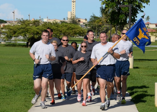 Members of Team Andersen participate in the 24-hr vigilance run to recognize prisoners of war and those missing in action, Sept. 19, 2014, on Andersen Air Force Base, Guam. During the run, squadrons throughout the base ran in one hour increments to honor our POW/MIA. (U.S. Air Force photo by Senior Airman Cierra Presentado/Released)