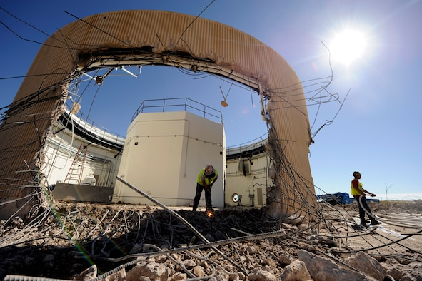 A demolition crew dismantles a Colorado Tracking Station antenna building Sept. 19, 2014, at Schriever Air Force Base, Colo. The 22nd Space Operations Squadron will officially decommission the tracking station, known as PIKE, during a ceremony Sept. 29, 2014. (U.S. Air Force photo/Dennis Rogers)