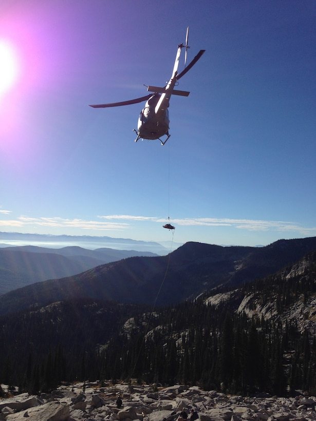 Ammi Midstokke is being hoisted onto a UH-1N Iroquois helicopter from the 36th Rescue Flight Sept. 20, 2014, near Priest Lake, Idaho. It took the combination and teamwork of and an eight-man Priest Lake Search and Rescue ground team and a four-man crew from Fairchild Air Force Base, Washington, to complete the rescue mission. (Courtesy photo/Jason Luthy)