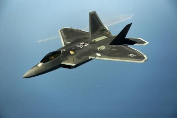 A U.S. Air Force F-22 maneuvers after being in-air refueled April 25, 2014, over the U.S. Central Command Area of responsibility by a KC-135 Stratotanker and aircrew from the 340th Expeditionary Air Refueling Squadron, Al Udeid Air Base, Qatar. The F-22 Raptor is an advanced capability aircraft that can be provided to the Combined Forces Air Component Commander within the region to enhance missions supporting stability and security. (U.S. Air Force photo by Staff Sgt. Vernon Young Jr.)
