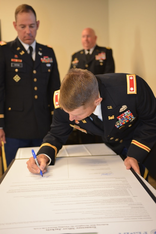 U.S. Army Corps of Engineers Nashville District Commander, John L. Hudson, signs  the Tennessee Silver Jackets charter at a ceremony Sept. 23, 2014 at Metro Nashville's Development Services Center.  Silver Jackets is an innovative program that provides an opportunity to consistently bring together multiple state, federal, and local agencies to learn from one another and apply their knowledge to reduce risk.