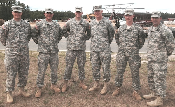 Army Cadet James Oliver (second from right) a civil engineering student in the Reserve Officers Training Corps at the University of Portland (Oregon), has completed an internship with the U.S. Army Corps of Engineers, New York District, receiving a variety of professional development experiences prior to his senior year of college. Here he stands with District leadership and fellow cadets at Joint Base McGuire-Dix-Lakehurst in New Jersey during a site visit July 29, 2014. From Left to Right: Capt. Tim Shebesta,  Cadets Jacob Woicik and Ryan Bunn, District Commander Col. Paul Owen, and Lt. Col. Scott Figlioli (far right).