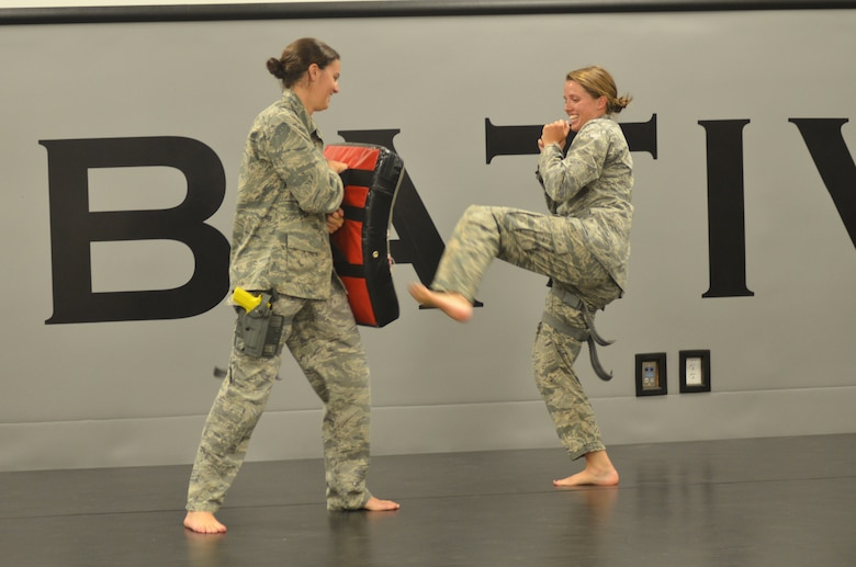 Academy cadets Sydney Rower (left) and Abby Wolters spar during a Combative Class here Sept. 19. The three-part course is a graduation requirement for cadets. (U.S. Air Force photo/Amber Baillie)