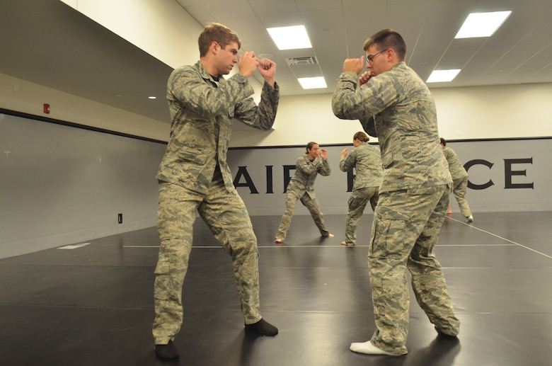 Academy cadets Jackson Bell (left) and Robert Goodno spar during the Academy's Combatives course here Sept. 19. The three-part course is a graduation requirement for cadets. (Air Force photo/Amber Baillie)