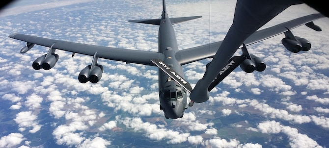 A KC-135R Stratotanker flown by a 465th Air Refueling Squadron crew from Tinker Air Force Base refuels a B-52 Stratofortress over the skies of Texas, Aug. 17. The B-52 crew flew out of Barksdale AFB and conducted several aerial refueling evaluations during the training exercise. (U.S. Air Force photo/Maj. Jon Quinlan)