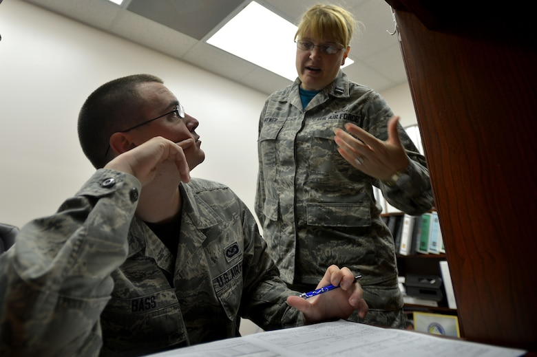 U.S. Air Force Capt. Kimberly Brewer, 20th Medical Operations Squadron clinical nurse, explains how to fill out the Department of Defense C.W. Bill Young Bone Marrow Program packet to Airman 1st Class Jonathan Bass, 20th Fighter Wing public affairs photojournalist at Shaw Air Force Base, S.C., Sept. 19, 2014. Becoming a potential bone marrow donor starts with a simple mouth swab. (U.S. Air Force photo by Staff Sgt. Kenny Holston/Released)