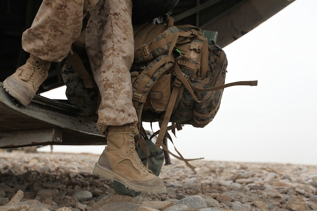 A Marine wearing Rugged All Terrain boots disembarks from a helicopter in Afghanistan. Two pairs of RAT boots, a temperate variant and hot variant, like the ones pictured above, will be issued to Marine Corps recruits and officer candidates in their sea bags starting Dec. 1.