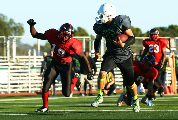 Marine Corps Base Spartans' Bryce Pruitt scores a touchdown against the Miramar Falcons during a Commanding General's Cup football game at the Paige Fieldhouse football field, Sept. 23. The Spartans defeated the Falcons with a score of 34-0. (Photo by Cpl. Shaltiel Dominguez)