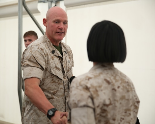 Sgt. Maj. of the Marine Corps Micheal P. Barrett addresses a Marine with Battery A, Ground Combat Element Integrated Task Force during a visit to the GCEITF headquarters, Sept. 23, 2014. Barrett spoke with the Marines and gave them Sergeant Major of the Marine Corps coinsas a show of appreciation for their commitment to the task force. From October 2014 to July 2015, the GCEITF will conduct individual and collective level skills training in designated ground combat arms occupational specialties in order to facilitate the standards based assessment of the physical performance of Marines in a simulated operating environment performing specific ground combat arms tasks. (Marine Corps photo by Cpl. Paul S. Martinez/Released)