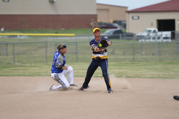 Air Force Master Sgt. Nicole Gill (left) slides safe with Navy Petty Off. 3rd Class Shasta Rodriguez on the catch at the 2014 Armed Forces Softball Championship at Fort Sill, Okla. 14-19 Sept.