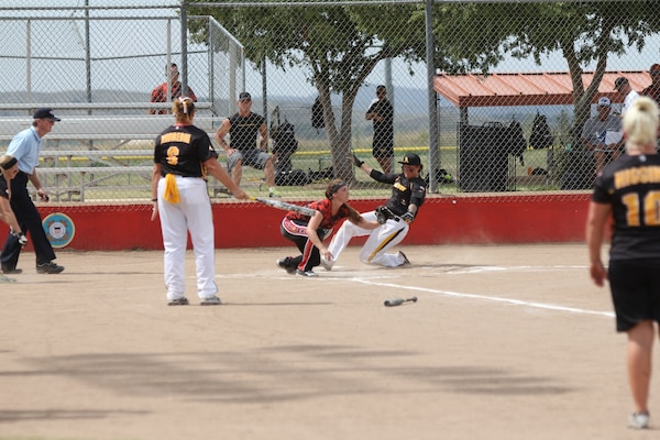 Army Sgt. Leina Braxton slides in for the score against Marine Corps at the 2014 Armed Forces Softball Championship at Fort Sill, Okla. 14-19 Sept.