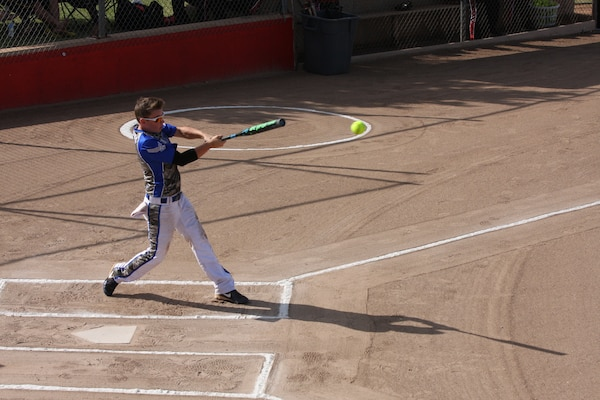 Air Force Senior Airman Terri Hodges smashes the ball for extra bases at the 2014 Armed Forces Womens Softball Championship