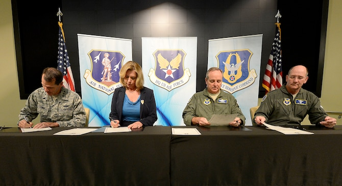 Leaders of the Air Force and the Air Reserve Component sign the Total Force Aircrew Management charter Sept. 18, 2014, during the Aircrew Summit at Joint Base Andrews, Maryland. From left to right, Director of Air National Guard Lt. Gen. Stanley E. Clarke; Secretary of the Air Force Deborah Lee James; Air Force Chief of Staff Gen. Mark A. Welsh, III; and Chief of Air Force Reserve Lt. Gen. James A. Jackson, prepare to sign the charter, which integrates total-force management of resources across the active duty, Guard and Reserve to maximize combat readiness. (U.S. Air Force photo/Scott Ash)