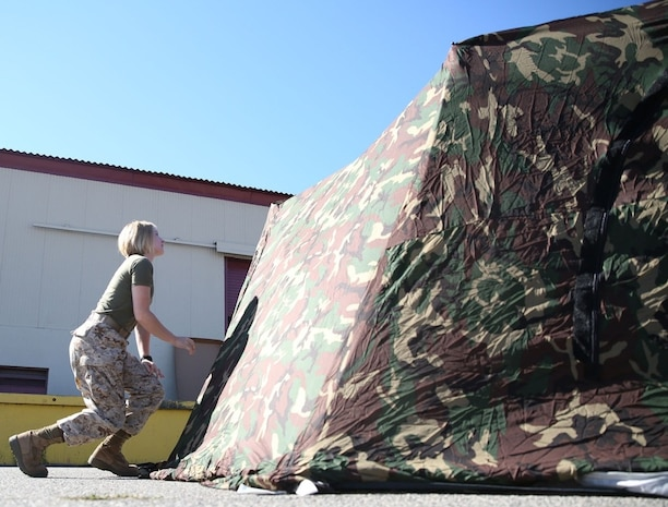 Private Sarah Trull, a fiscal clerk with Marine Air Group 39, puts together an Arctic shelter Aug. 29, 2014, aboard Camp Pendleton, California. The system is an ultra-lightweight, rapidly deployable shelter that offers military forces the necessary infrastructure to operate in austere cold-weather locations. The system is being used for training exercises in Bridgeport, California, and is slated to be integrated into exercises early next year.