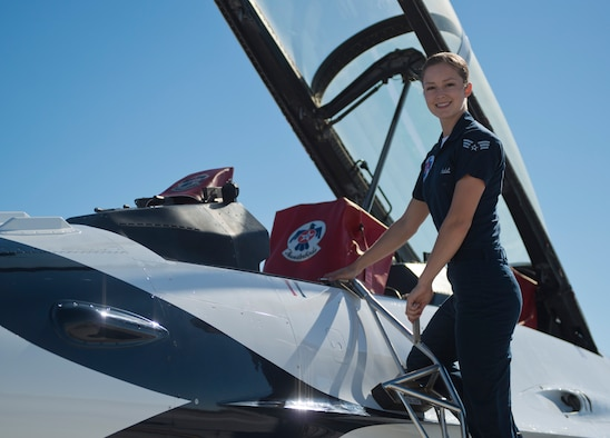 U.S. Air Force Senior Airman Ariel Audet, U.S. Air Force Demonstrations Squadron crew chief, poses on a jet Sept. 19, 2014, at Mountain Home Air Force Base, Idaho. Audet is one of 120 enlisted personnel assigned to the Thunderbirds team which is based out of Nellis Air Force Base, Nev. (U.S. Air Force photo by Airman 1st Class Brittany A. Chase/Released)