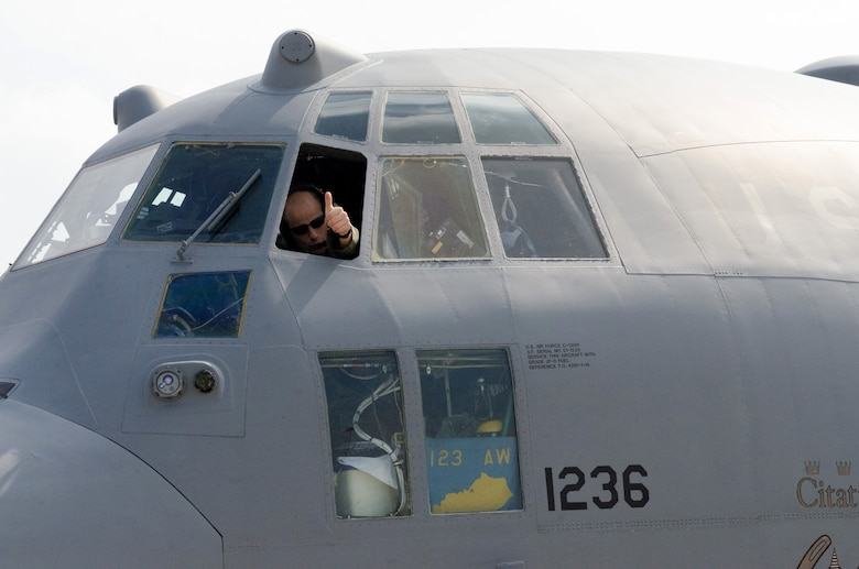 Air Force Lt. Col. Charles Hans, an aircraft commander with the Kentucky Air National Guard's 123rd Airlift Wing, communicates with ground crews from the cockpit of his C-130 Hercules aircraft after returning from an airdrop mission in the Baltic region on Sept. 8, 2014, during Operation Saber Junction. The 123rd participated in the training exercise along with five other Air Guard units and troops from 17 NATO countries. (U.S. Air National Guard photo by 2nd Lt. James W. Killen)