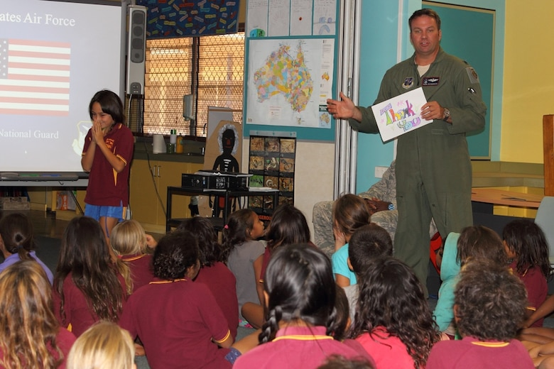 Lt. Col. Eric Haagenson, pilot, 113th Wing, D.C. Air National Guard, accepts a thank-you note from Australian primary school students at McFarlane Primary School in Katherine, Australia, during the unit's visit, Sept. 17.  (U.S. Air National Guard photo/Airman 1st Class Aaron Church)
