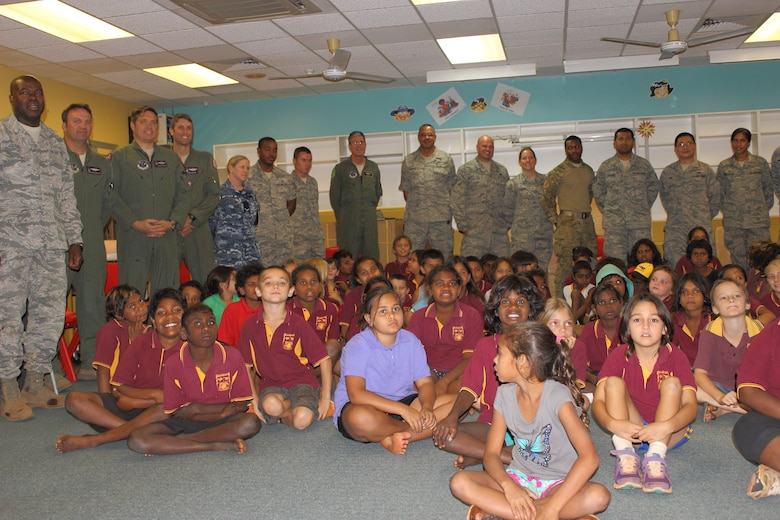Members of the District of Columbia's Air National Guard's deployed 121st Expeditionary Fighter Squadron pose for a picture with McFarlane Primary School students in Katherine, Australia, during a visit, Sept. 17.  (U.S. Air National Guard photo/Airman 1st Class Aaron Church)