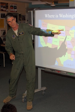 Flight surgeon Lt. Col. Jim Doyle tells Australian youngsters about the District of Columbia Air National Guard's home city with a short geography lesson on a visit to McFarlane Primary School, near the unit's deployed location at RAAF Tindal, Australia, Sept. 17. (U.S. Air National Guard photo/Airman 1st Class Aaron Church)