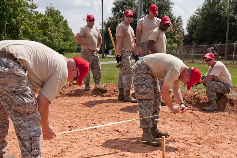 Members of the 307th RED HORSE construct forms for concrete at Barksdale Air Force Base, La., Sept. 8, 2014. A total of four slabs were poured Sept. 9, 2014, three for new athletic equipment along one of the running trails and one for parking at the 93rd Bomb Squadron building. (U.S. Air Force photo by Master Sgt. Jeff Walston/Released)