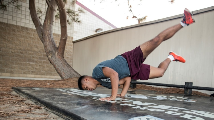U.S. Marine Lance Cpl. Lance Allen T. Sanchez relieves stress by breakdancing aboard Camp Pendleton, Calif., Sept. 22, 2014. Sanchez, 21, is from Tamuning, Guam and is a food service specialist with 15th Marine Expeditionary Unit. (U.S. Marine Corps photo by Sgt. Emmanuel Ramos/Released)