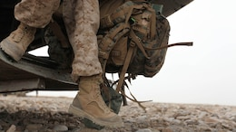 A Marine wearing Rugged All Terrain boots disembarks from a helicopter in Afghanistan. Two pairs of RAT boots, a temperate variant and hot variant, like the ones pictured above, will be issued to Marine Corps recruits and officer candidates in their sea bags starting Dec. 1, 2014.