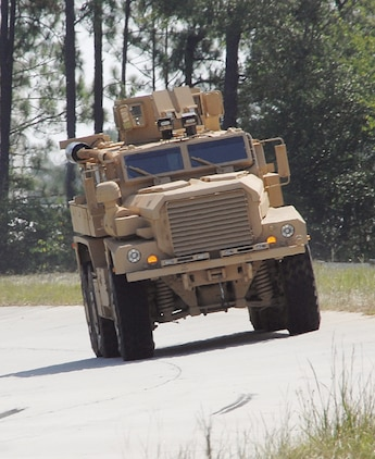 A Category II A1 Cougar Mine-Resistant, Ambush-Protected vehicle runs laps around Marine Depot Maintenance Command/Production Plant Albany's test track recently performing final operational testing before being sent to the warfighter.