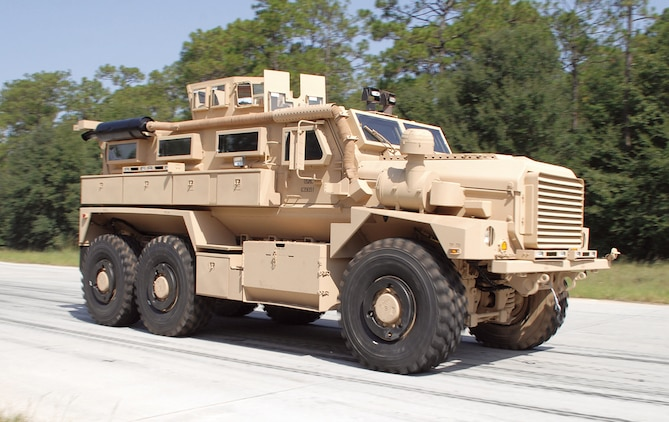 A Category II A1 Cougar Mine-Resistant, Ambush-Protected vehicle runs laps around the Marine Depot Maintenance Command/Production Plant Albany's test track performing final operational testing prior to being sent to the warfighter.