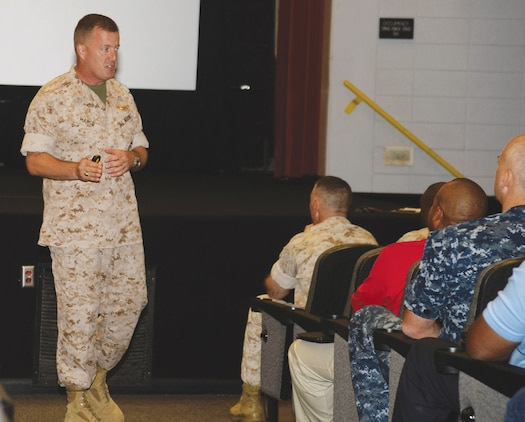 Col. Damien M. Marsh, inspector general, Office of the Inspector General of the Marine Corps, outlines the purpose for the team's visit to Marine Corps Logistics Base Albany. The 20-member team inspected various offices aboard the installation this week.
