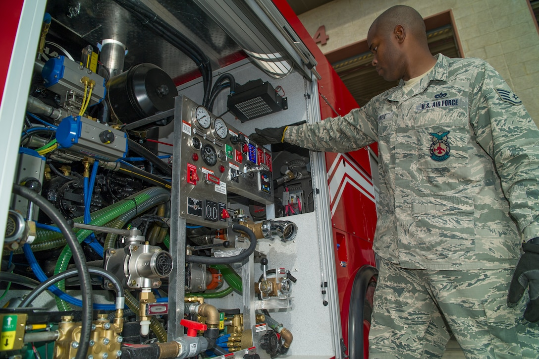 Staff Sgt. Phillip Daniels, 49th Civil Engineer Squadron Fire Protection Flight firefighter, performs routine user maintenance on the new P-34 Rapid Intervention Vehicle at Holloman Air Force Base, N.M., Sept. 21, 2014.. The RIV is three times more cost effective than the conventional firefighting vehicles. The combination of water and firefighting foam discharges at 1,350 pounds per square inch and increases the length of time that the RIV can remain on scene without having to be resupplied. (U.S. Air Force photo by Airman 1st Class Aaron Montoya)