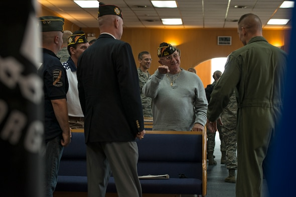 Col. Brook Leonard, 51st Fighter Wing commander, chats with members from the Veterans of Foreign Wars organization after a Prisoners of War/Missing in Action remembrance ceremony Sept. 25, 2014, at Osan Air Base, Republic of Korea. Team Osan observed a POW/MIA memorial week with the remembrance ceremony, a reveille and retreat ceremony, and a 24-hour run. (U.S. Air Force photo by Staff Sgt. Jake Barreiro/Released)