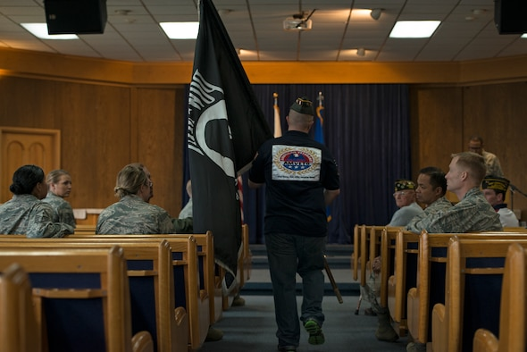 A member of the Veterans of Foreign Wars prepares to place the Prisoners of War/Missing in Action flag on the podium during a POW/MIA remembrance ceremony Sept. 25, 2014, at Osan Air Base, Republic of Korea. POW/MIA remembrance day is traditionally observed on the third Friday of September, but Team Osan held a POW/MIA remembrance week Sept. 19 - Sept. 26. (U.S. Air Force photo by Staff Sgt. Jake Barreiro/Released)
