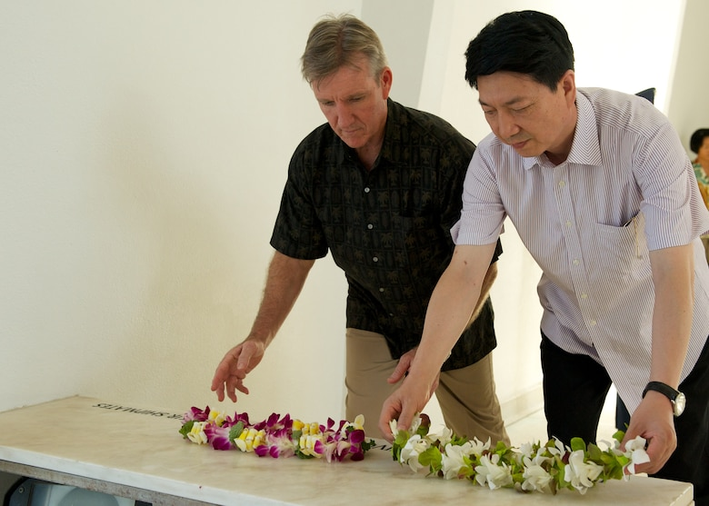 Gen. Hawk Carlisle, Pacific Air Forces commander (left), and Lt. Gen. Huang Guoxian (right), commander Nanjing Military Regional Air Force Command, lay wreaths to pay respect to the men and women lost in the attack on Pearl Harbor.  Carlisle hosted Huang and a delegation of People's Liberation Army Air Force officers as part of a reciprocal visit key to building a strong military to military relationship between the U.S. and China. (U.S. Air Force photo by Tech. Sgt. James Stewart/Released)