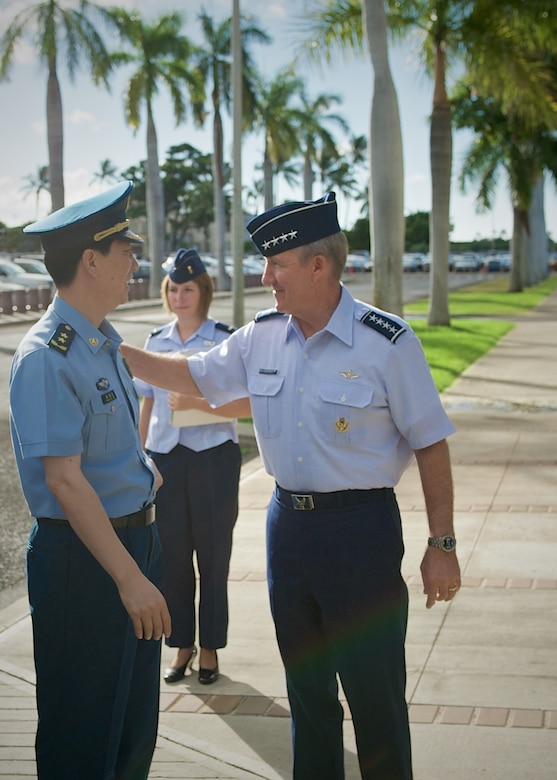 Gen. Hawk Carlisle, Pacific Air Forces commander (right), greets Lt. Gen. Huang Guoxian (left), commander Nanjing Military Regional Air Force Command, Sept. 23, 2014, Joint Base Pearl Harbor-Hickam, Hawaii.  Carlisle hosted Huang and a delegation of People's Liberation Army Air Force officers as part of a reciprocal visit key to building a strong military to military relationship between the U.S. and China. (U.S. Air Force photo by Tech. Sgt. James Stewart/Released)