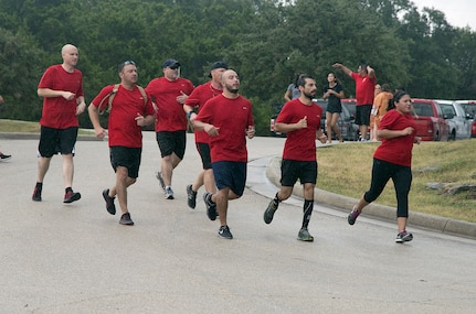 Rambler 120 participants run as a team toward the finish line during the mystery event portion of the annual Rambler 120 Competition Sept. 20 at Joint Base San Antonio Recreation Park at Canyon Lake. The Rambler 120, which is hosted by the 502nd Force Support Squadron, features four- and eight-person teams that engage in a friendly, but hard-fought, competition that challenges participants with a 22-mile bike race, 6-mile run, 2-mile raft race and a mystery event. (U.S. Air Force photo by Johnny Saldivar)