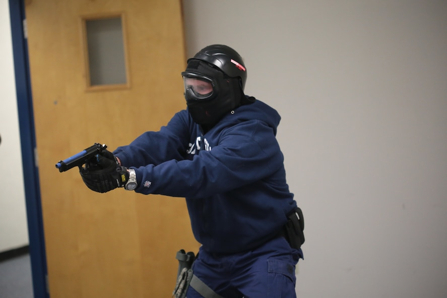 U.S. Coast Guard Petty Officer 1st Class Seth Tucker clears a room during active shooter training at Atlantic Cape Community College in Mays Landing, N.J. on Sept. 24, 2014. New Jersey Air National Guard, U.S. Coast Guard, and local law enforcement officers were taught Active Shooter Level I training by an Air Force Reserve mobile training team from the 610th Security Forces Squadron, which is based out of Naval Air Station Joint Reserve Base Fort Worth. Tucker is a Gunner's Mate assigned to Coast Guard Air Station Atlantic City. (U.S. Air National Guard photo by Tech. Sgt. Matt Hecht/Released)