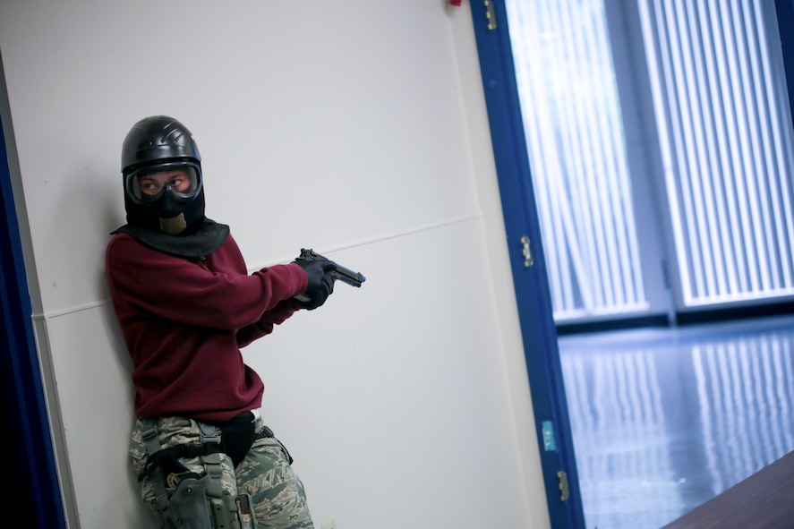 U.S. Air Force Staff Sgt. Stardust Santiago from New Jersey Air National Guard's 177th Security Forces Squadron provides rear security for an entry team during active shooter training at Atlantic Cape Community College in Mays Landing, N.J. on Sept. 24, 2014. New Jersey Air National Guard, U.S. Coast Guard, and local law enforcement officers were taught Active Shooter Level I training by an Air Force Reserve mobile training team from the 610th Security Forces Squadron, which is based out of Naval Air Station Joint Reserve Base Fort Worth. (U.S. Air National Guard photo by Tech. Sgt. Matt Hecht/Released)