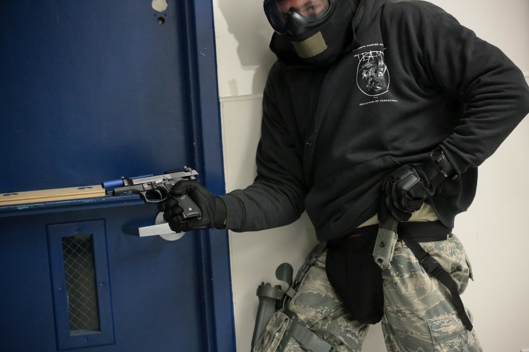 U.S. Air Force Master Sgt. Jeffrey Tafrow from New Jersey Air National Guard's 177th Security Forces Squadron reloads after engaging a simulated shooter during active shooter training at Atlantic Cape Community College in Mays Landing, N.J. on Sept. 24, 2014. New Jersey Air National Guard, U.S. Coast Guard, and local law enforcement officers were taught Active Shooter Level I training by an Air Force Reserve mobile training team from the 610th Security Forces Squadron, which is based out of Naval Air Station Joint Reserve Base Fort Worth. (U.S. Air National Guard photo by Tech. Sgt. Matt Hecht/Released)