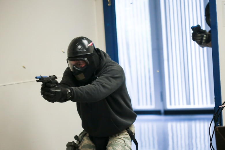 A picture of U.S. Air Force Master Sgt. Jeffrey Tafrow from New Jersey Air National Guard's 177th Security Forces Squadron entering a room and engaging a simulated shooter.