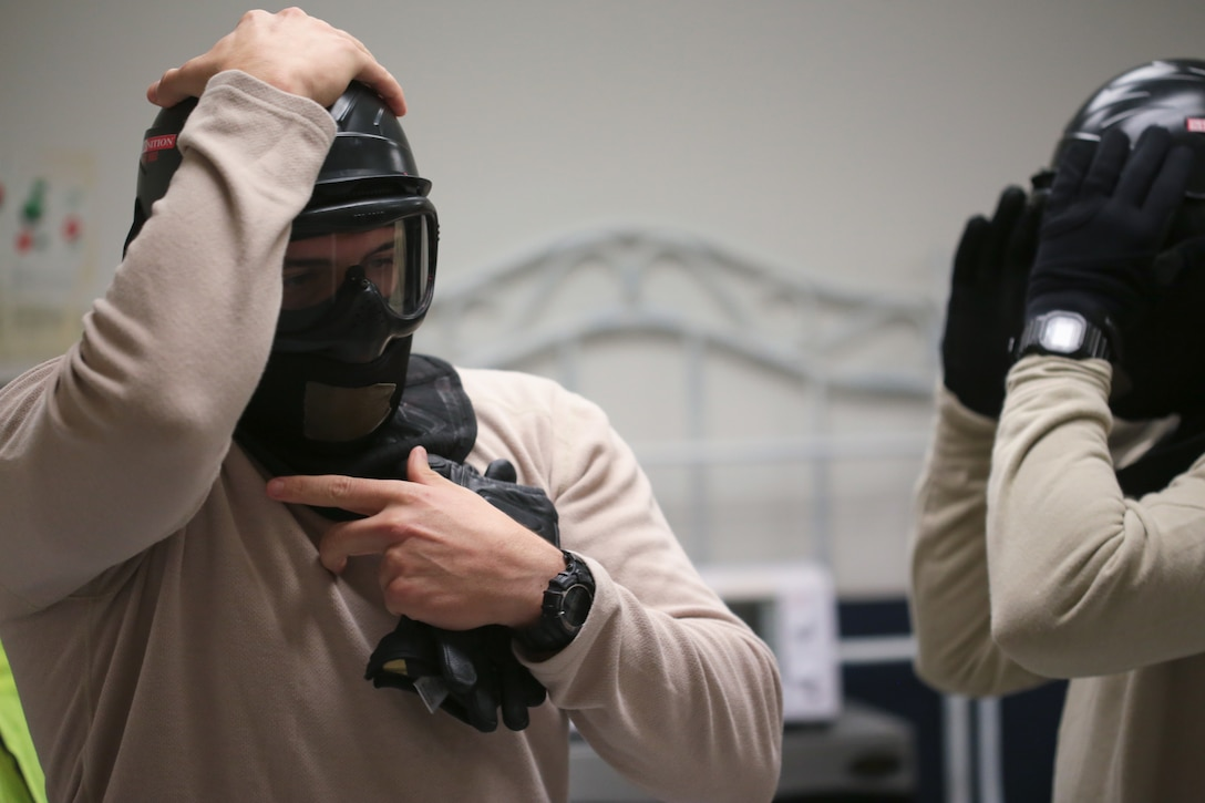 U.S. Air Force Airmen from New Jersey Air National Guard's 177th Security Forces Squadron put on protective gear prior to a scenario during active shooter training at Atlantic Cape Community College in Mays Landing, N.J. on Sept. 24, 2014. New Jersey Air National Guard, U.S. Coast Guard, and local law enforcement officers were taught Active Shooter Level I training by an Air Force Reserve mobile training team from the 610th Security Forces Squadron, which is based out of Naval Air Station Joint Reserve Base Fort Worth. (U.S. Air National Guard photo by Tech. Sgt. Matt Hecht/Released)