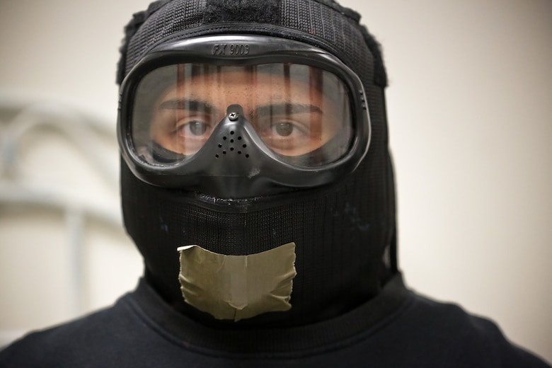 A picture of U.S. Air Force Airman 1st Class John Stakeman from the 177th Security Forces Squadron waiting for an active shooter scenario to start.