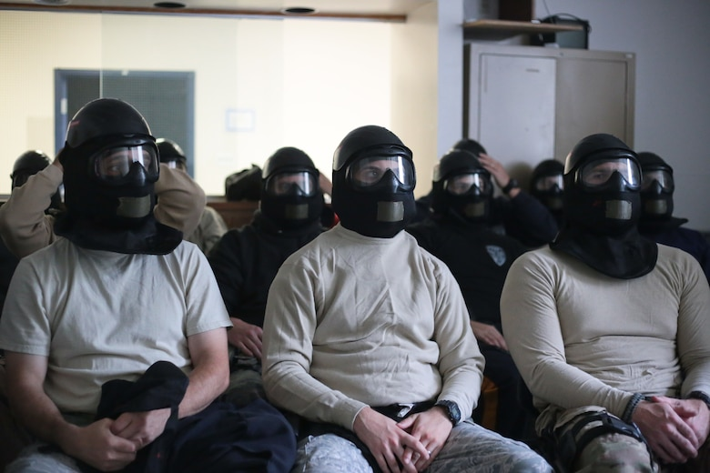 A picture of New Jersey Air National Guard, U.S. Coast Guard, and local law enforcement officers wearing protective gear during active shooter training.